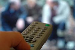 TV viewing tops four hours and 48 ads a day