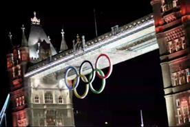Olympic rings:hoisted into place on Tower Bridge