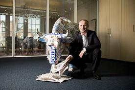 Bullish Auckland: Pictured here with a cow made from Metro newspapers