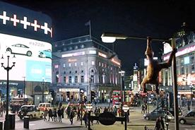 SSE: Maya the orangutan swings from a lamppost in Piccadilly Circus in  TV ad