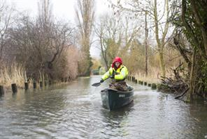 Volunteer James Wilson uses his canoe to transport supplies to residents