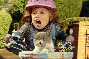 Five year-old girl and her cat rock out to 'We Built This City' for Three ad