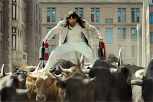 A bewigged Jason Statham 'bull surfs' in a Statham fantasy world for bizarre LG spot