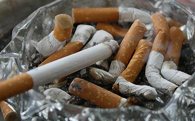 Axa to sell off €1.7bn tobacco investments as government anti-smoking moves march on