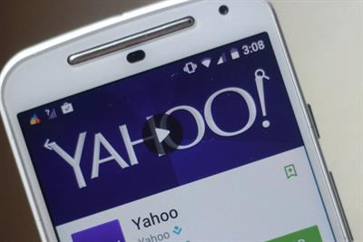 Yahoo reports revenue of $1.3bn and says Verizon deal is on track