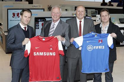 Leyton Orient: chairman Barry Hearn second from left and new sponsored club shirts