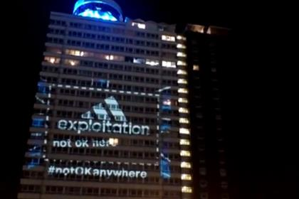 War on Want: targeted Adidas with tower block projection