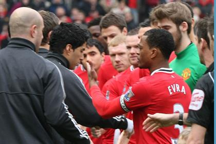 Race row: Luis Suarez refused to shake Patrice Evra's hand (Getty Images)
