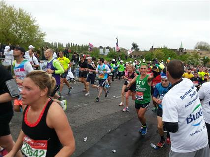 Dr Bingham (wearing a green vest with 'Stu' on) in the London marathon