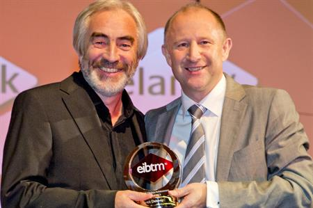 Patrick Delaney (left) picks up lifetime achievement award at EIBTM