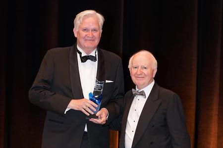 Henrik von Arnold receives his Academy Award for Europe from IMEX's Ray Bloom
