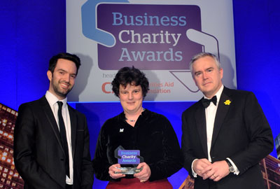 Business Charity Award winner Kate Neville with Third Sector's Alex Hay [left] and BBC News presenter Huw Edwards