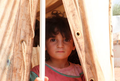 A child at the Atma refugee camp on the Turkish-Syrian border