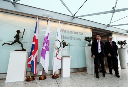 Olympic task: Lord Coe greets IOC president Jacques Rogge at Heathrow