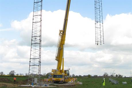 Going up Met mast installation at Vatenfall&#39;s Swindford wind farm in the UK