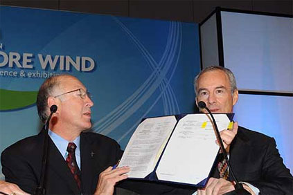 Interior secretary Ken Salazar and Cape Wind president Jim Gordon sign the first offshore wind farm lease