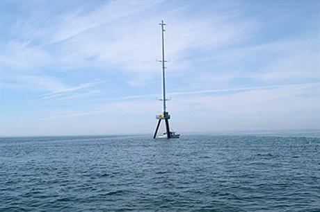 A meteorological mast in place at the site