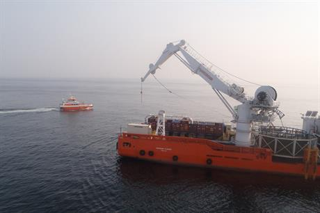 The cable-laying vessel in action