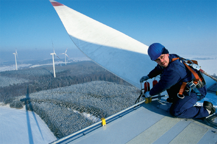 A worker braves the cold to service a Vestas V80 turbine in Germany