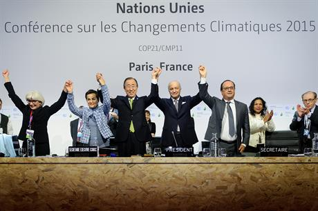French foreign minister Laurent Fabius (centre) celebrates with UN secretary general Ban Ki Moon (third from left) and French President Francois Hollande (fifth from left)