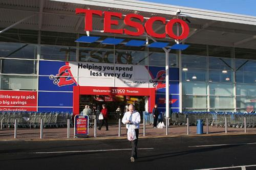 Tesco trio charged with fraud