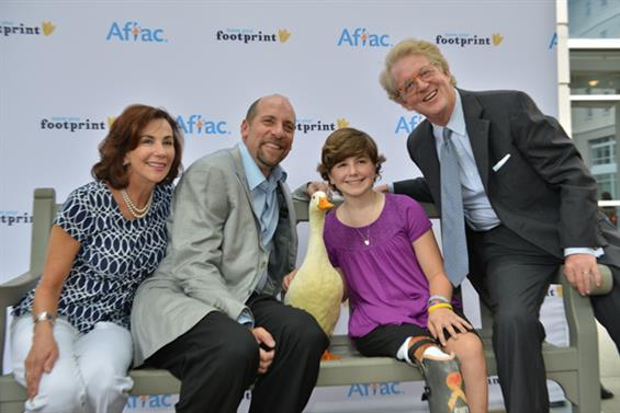 Former MLB pitcher John Smoltz (second from left) was honored at the awards last September for the work he has done for the cause