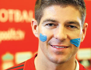 Liverpool's Steven Gerrard daubed with blue paint at the launch of Blue September