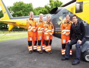 Rob Lowe with staff from Warwickshire & Northamptonshire Air Ambulance
