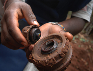 A MAG deminer removes the fuse from a landmine. Credit: Sean Sutton / MAG.