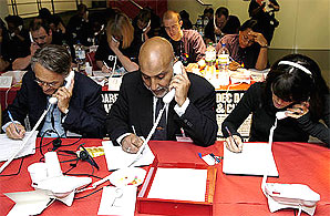 Mike Lake, chief executive of Help the Aged (left), Hany El Banna, director of Islamic Relief (middle), and TV presenter Claudia Winkleman answer phones at the launch of the DEC's Darfur appeal. Photo: Rachel Palmer/Save the Children
