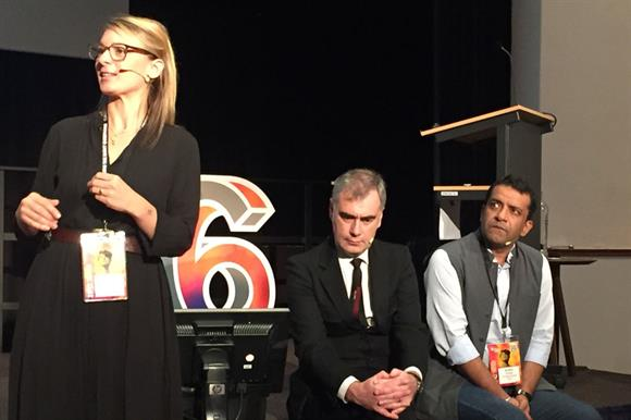 Crombie speaks as MacQuillin (centre) and Gupta listen