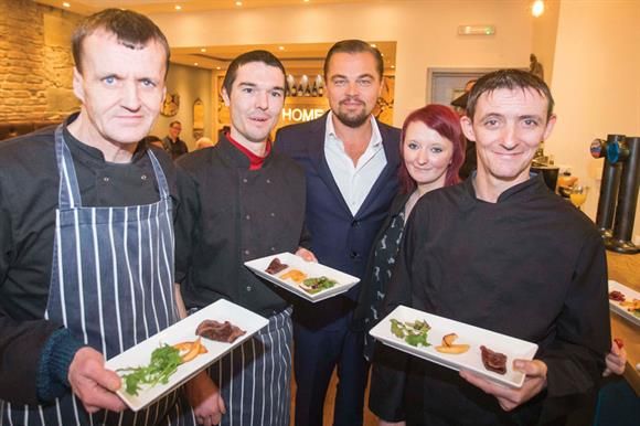 Leonardo DiCaprio with staff at the Edinburgh restaurant Home