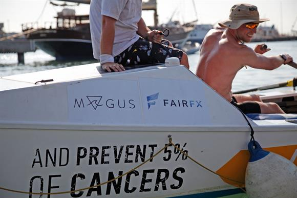 A competitor completes a 72-hour rowing race for the HPV and Anal Cancer Foundation
