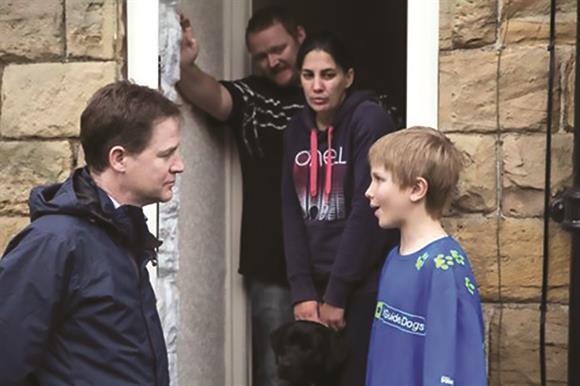 Former Lib Dem leader Nick Clegg meets Freddie, a 10-year-old volunteer for Guide Dogs