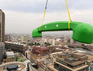 Calling the City: phone is hoisted in Moorgate