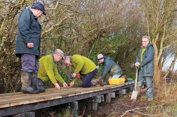 Older volunteers working for Ramblers in Anglesey, Wales