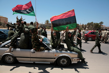 Libyan rebels: protesting Gaddafi rule [pic Rex Features]