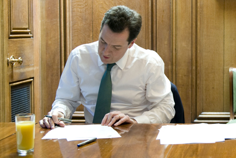 Balancing act: George Osborne works on his Budget speech (Credit: Rex Features)