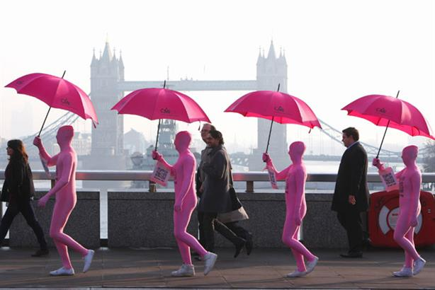 In the pink: commuters get a helping hand from the CMI's pink Shadowmen