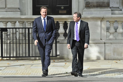 Aid debate: David Cameron and Liam Fox