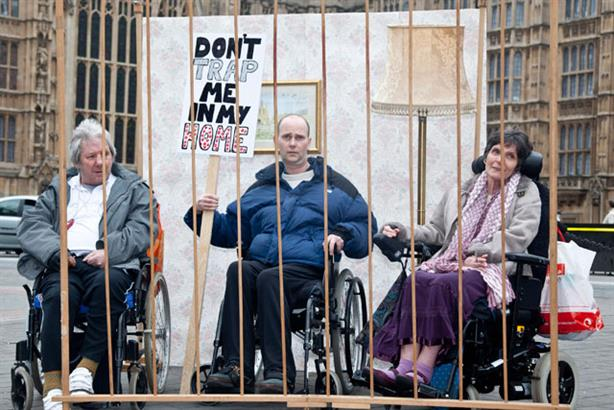 Fighting to get out: disabled people pose behind bars to highlight their campaign, supported by a huge rally in London
