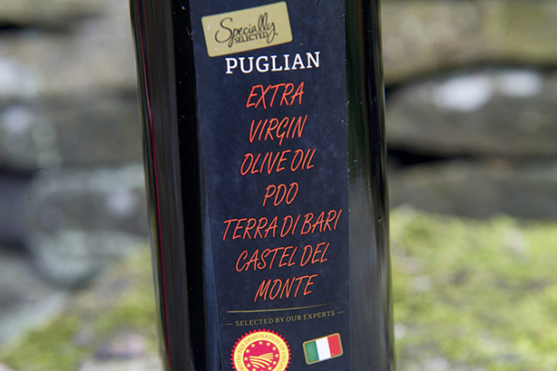 Aldi: unfortunate typography on the brand's luxury olive oil (Credit: Cavendish Press)