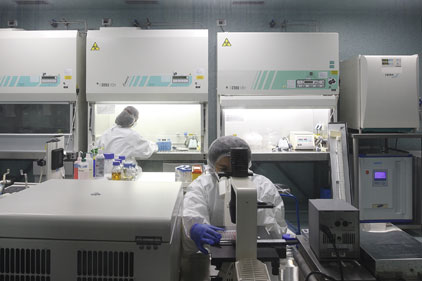 Novartis: technicians work on the 4CmenB vaccine