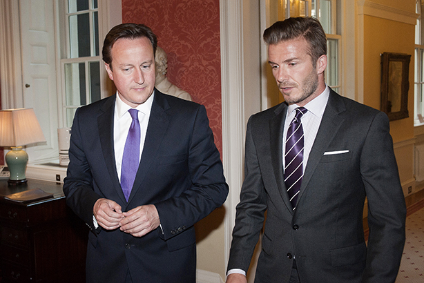 Teaming up: Cameron and Beckham (Credit: David Parker/AFP/Getty Images)