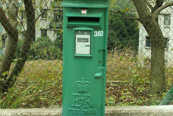 A cast-iron postbox with the UK royal insignia in Hong Kong