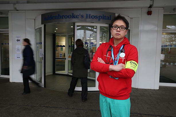 Dr Anthony Ng on the picket line outside Addenbrooke's Hospital in Cambridge in March (© Chris Radburn/PA Wire)
