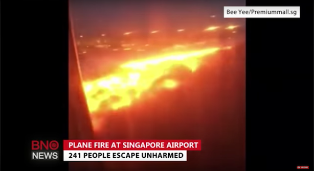 The wing of a Singapore Airlines flight caught fire after making an emergency landing. (Image via BNO News' YouTube account).