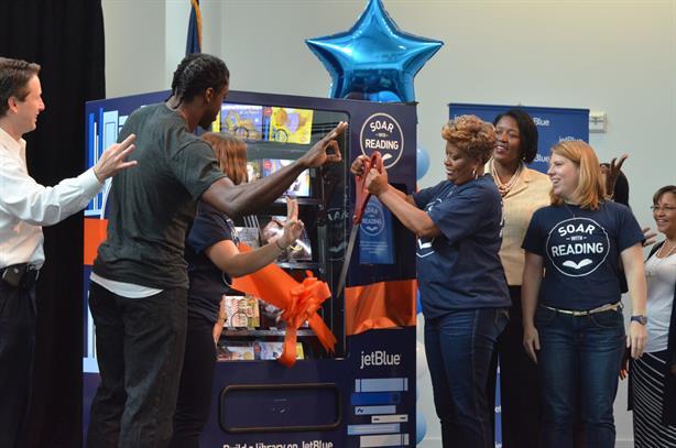 Redskins quarterback Robert Griffin III at book vending machine launch event.