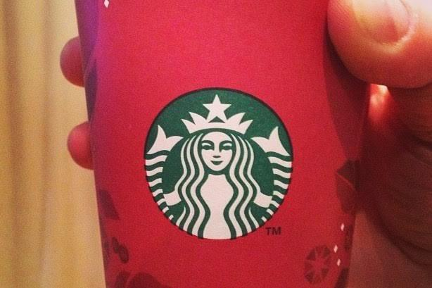 Starbucks has come under criticism this year for not adding seasonal decorations to its red cups. Previous designs, like the one above, were adorned with symbols of Christmas and winter.