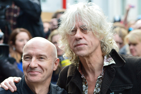 Departing: Live Aid legend Bob Geldof, right, with musician Midge Ure (Credit: Anthony Devlin/PA Wire)